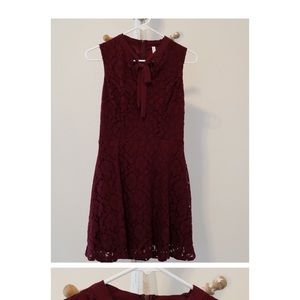 Maroon lacy cocktail dress.